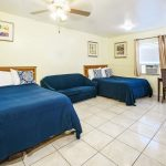 group room with two beds and blue sofa in between at Hollywood Beach Hotels