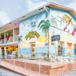 exterior mian building with mural of Hollywood Beach Hotels
