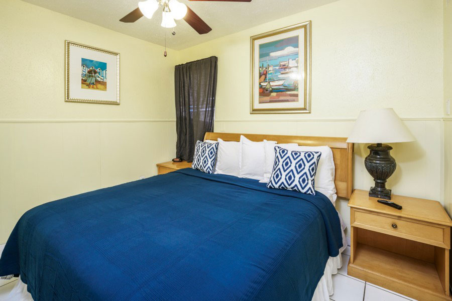 large be with blue blanket in one bedroom suite at Hollywood Beach Hotels